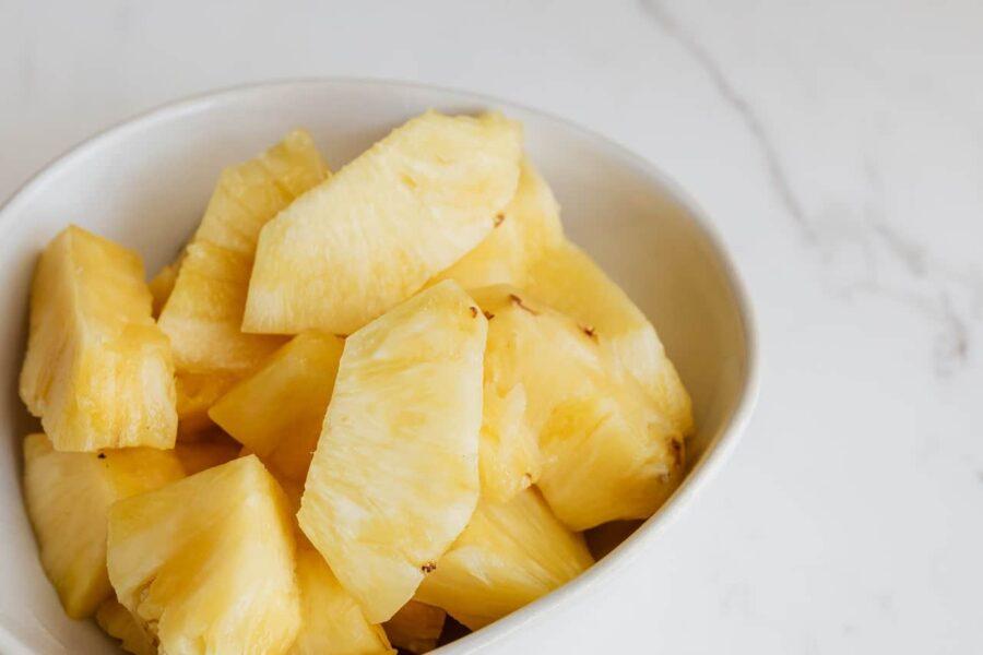 Juicy sliced pineapple in a bowl