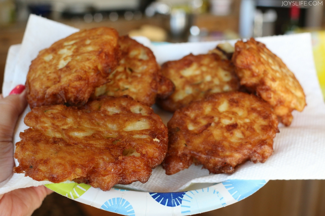 fried zucchini fritters paper plate