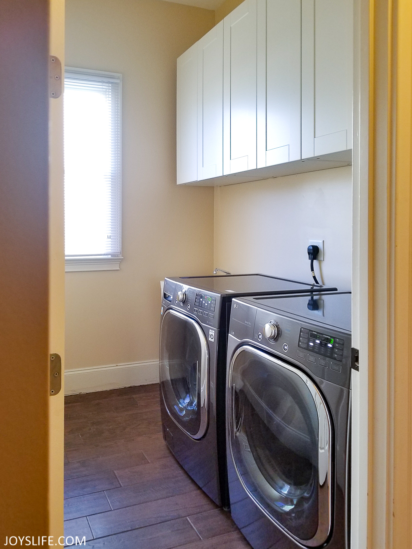 Laundry room with New Cabinets, new flooring, new appliances, new paint