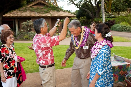 Supporter Howard Hanzaga bestows a lei on Mike White