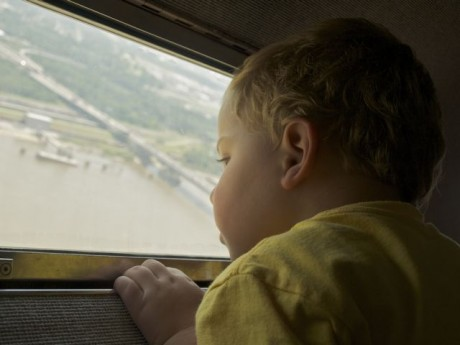 son looking at Mississippi River from St. Louis Arch