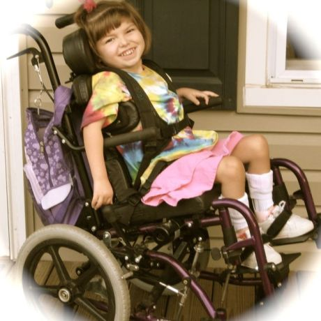 Elli in her wheelchair at age 6