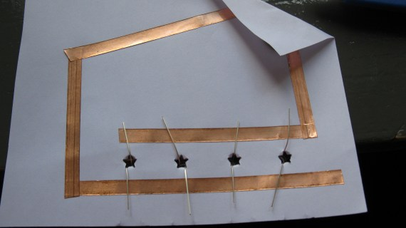 Remember that the positive prong of the LED has to touch the positive lane of copper tape.