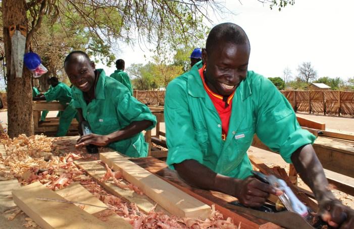 Skills development: Aniku Roy, 20 (foreground), and Ayikobua Brian, 18 (background) engage in carpentry training in Siripi, Rhino Refuggee Settlement. 29/03/2017
