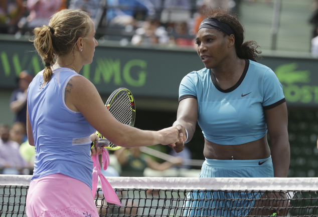 Serena Williams, right, shakes hands with Svetlana Kuznetsova, of Russia, left, after their match at the Miami Open tennis tournament, Monday, March 28, 2016, in Key Biscayne, Fla. Kuznetsova won 6-7 (3), 6-1, 6-2. (AP Photo/Lynne Sladky)