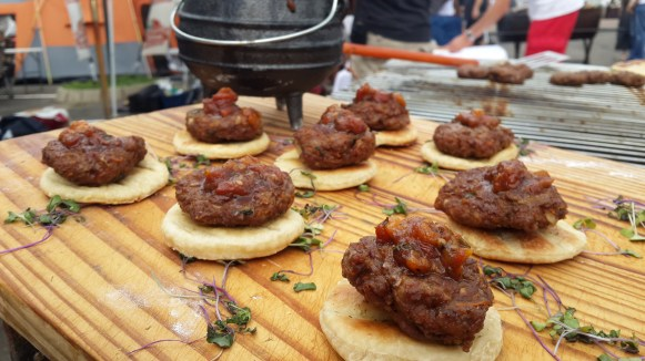 Ostrich burgers from Team The Roadies were grilled to perfection and succulent .