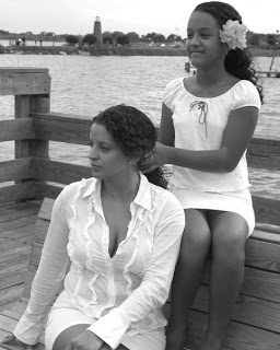 Lauressa and Dina mother and daughter picture in white dress braiding hair