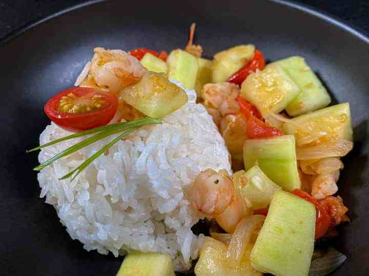 Sautéed Opo Squash with Steamed Rice in a Black Bowl