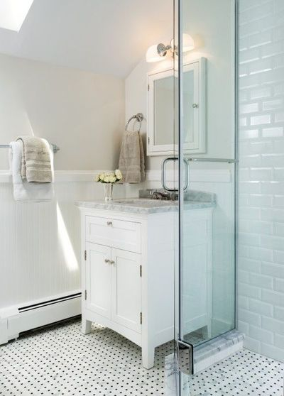 Lovely bathroom design with skylight greige walls chair
