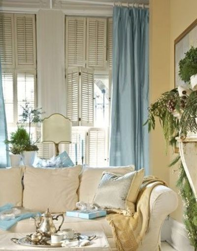 Yellow Walls, Blue Curtains / living room