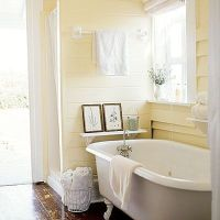 muted yellow bathroom-- don't think the pastel would sta ...
