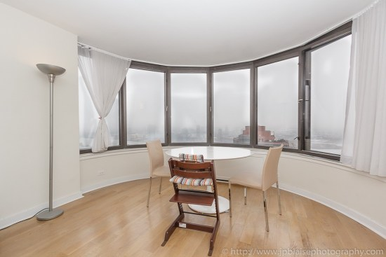 Apartment photographer work: living room of Midtown East unit in New York City with East River views