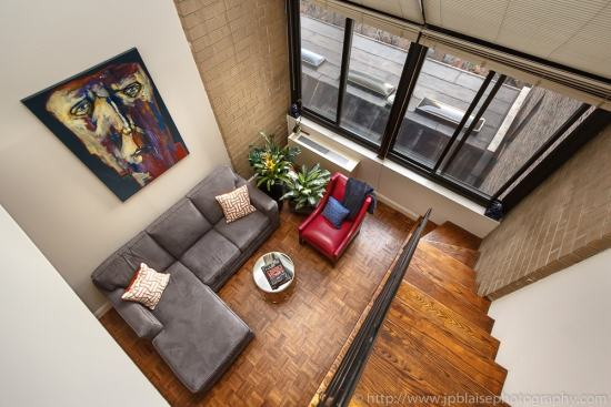 Interior photographer work, midtown apartment, view of the living room and the large window, new york city