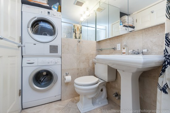 Bathroom with washer and dryer in the east village of NYC