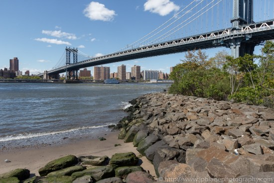 Interior photography views of the manhattan bridge and the manhattan skyline from the brooklyn waterfront