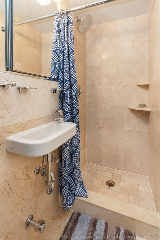 Real Estate photography of the bathroom of a 2 bedroom apartment in New York City