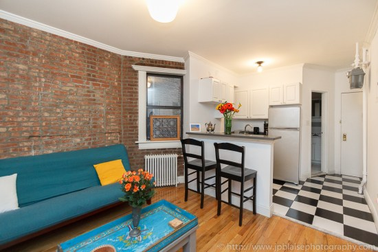Open kitchen in beautiful Soho three bedroom apartment with exposed brick wall