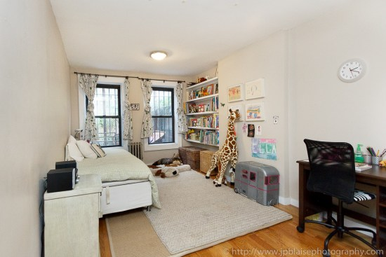 Interior photography of second bedroom of three bedroom apartment with private garden in Brooklyn