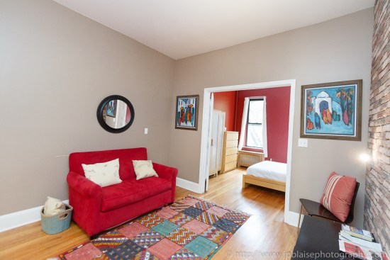 Photography of living room with red sofa of a property located in the Upper West Side of New York City