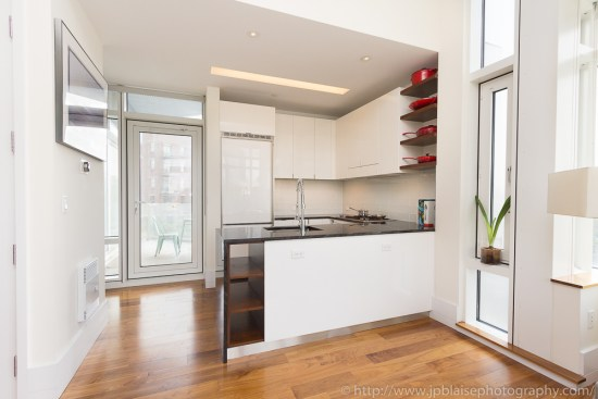 Interior picture of a large open Kitchen of luxury condominium in Queens, NY