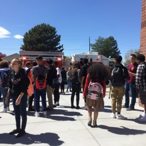 Students around a firetruck. By: Chris Moore