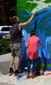 Alex Cook painting at The Mildred C. Hailey Apartments