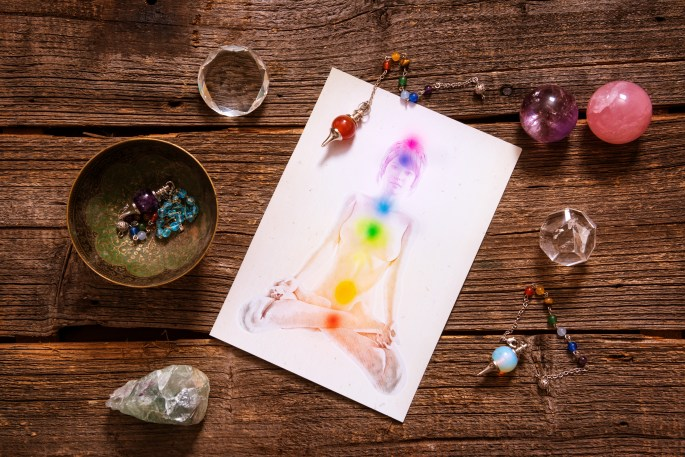Crystals and yoga drawing on table