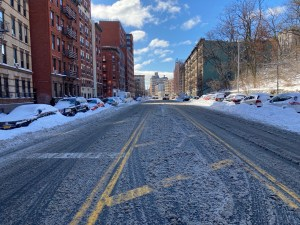 Street after snowstorm, Harlem, New York City.