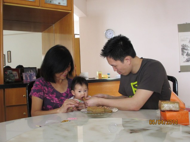 J sharing his cake with Baby E