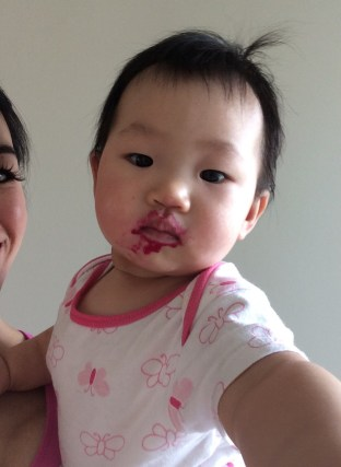 Stains around mouth after eating red dragonfruit.