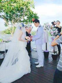 Groom receives bride from her father's hand.