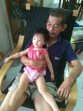 In the doting arms of my dad