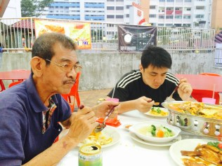 Dad and brother at dinner