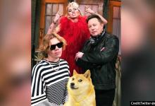 Elon Musk poses with singer Miley Cyrus on Saturday Night Live sets