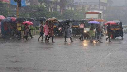 Mumbai on its knees as first day of monsoon drowns streets, railway tracks