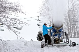 Treetops Resort mountain manager Doug Hoeh repositions a snow gun in December 2011.