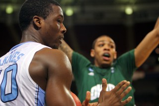 Harrison Barnes (white) calls timeout during the fourth quarter of North Carolina University's overtime win against Ohio University in the 2012 NCAA Tournament.
