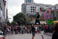 A street performer puts on a show in Vancouver.