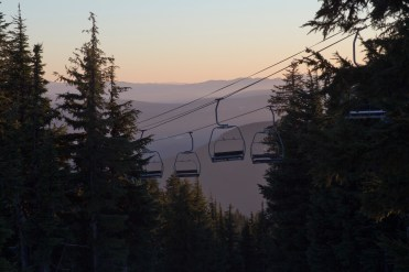 Chairlifts slow to a crawl at the end of an early-season ski day at Timberline Ski Area on Mount Hood in November 2015.