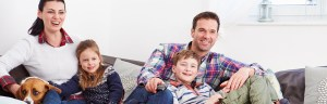 Personal Insurance Slider | Family on couch
