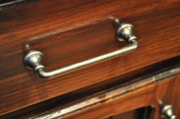 The new pulls are simple and complement the antiqued cabinet finish, creating a clean look.
