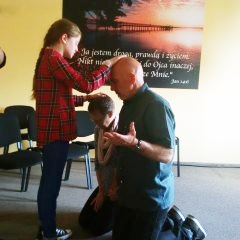 A young girl prophecying over John and Susan in Poland