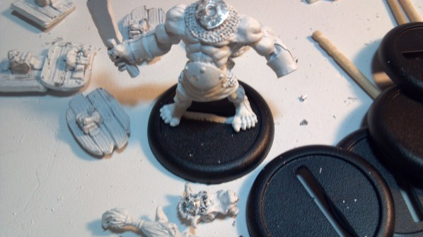 Trimmed orc miniature now fits his base. Click to Enlarge.