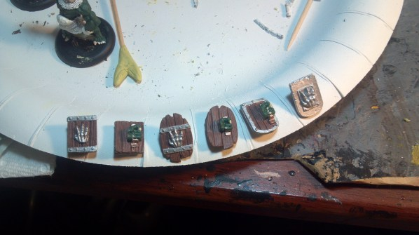 The six shields and the start of leather details. Click to Enlarge.
