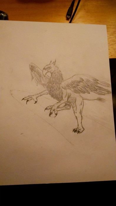 Working a little more on the griffin drawing at night. Click to Enlarge.