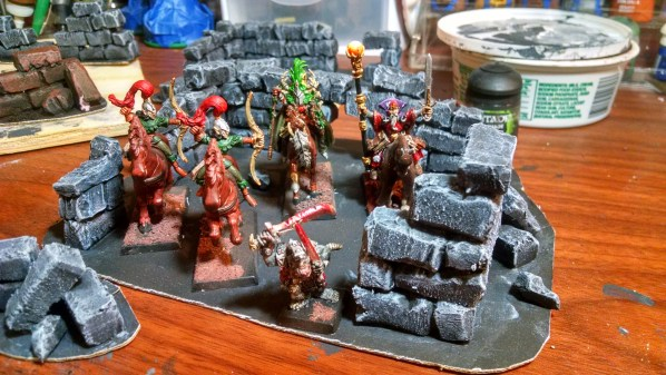 Hand painted miniatures on table top terrain ruins. Click to Enlarge.