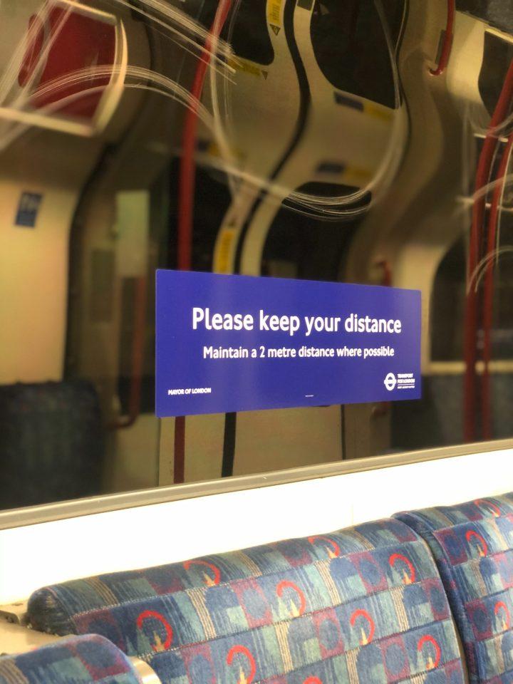 Social distance sign on Tube