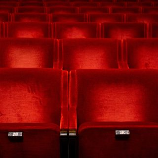 Red seats in auditorium in theatre