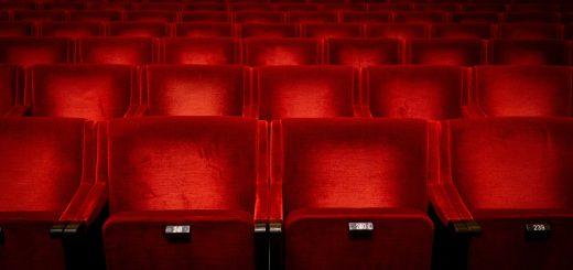 Red seats in auditorium in theatre