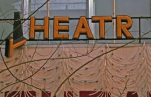 A broken Theatre sign